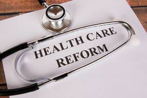 Health care reform with stethoscope
