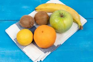 Healthy and fresh fruits on the kitchen dishcloth