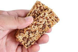 Healthy Bars with Sesame and Sunflower Seeds in the hand