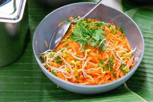 Healthy carrot salad with sprouts and green herbs, in a bowl at AXA Barcamp OMWest19 in Cologne, Germany