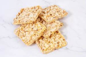 Healthy Corn Crackers on the white background (Flip 2019)