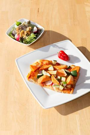 Healthy pizza with sweet potatoes and zucchini and chia/walnut salad