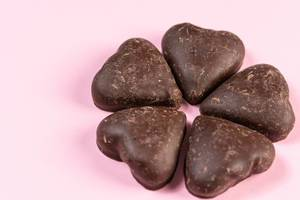 Heart shaped Chocolate on the pink background