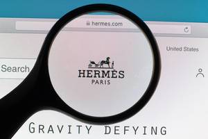 Hermes Paris logo under magnifying glass