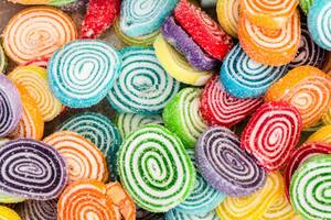High Angle View of the Bulk of Colorful Gummy Jelly Candy Rolls