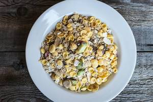 High Angle View of the Muesli in the White Plate on the Wooden Table