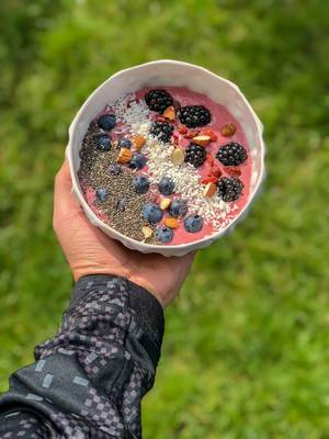 High Carb Bowl in hand. Blueberries, blackberries, almonds, chia and dried fruit