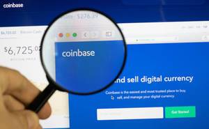 Highlighting Coinbase on the official website with a magnifying glass