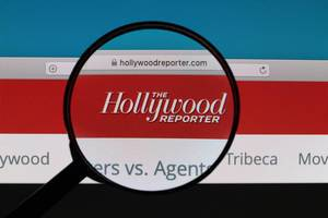 Hollywood Reporter logo under magnifying glass