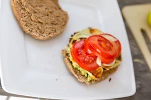 Home made halloumi-cheese burger with avocado and tomato