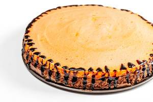 Homemade cake with chocolate biscuit, condensed milk and orange souffle
