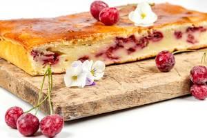 Homemade cherry pie on a wooden kitchen Board (Flip 2020)