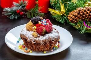 Homemade Christmas cupcake with strawberries, raspberries and mulberries (Flip 2019)