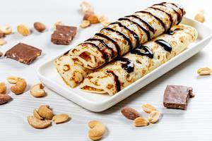 Homemade pancakes with chocolate topping and nuts (Flip 2019)