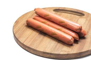 Hot dog Frankfurters isolated on the wooden board