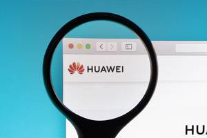Huawei logo under magnifying glass