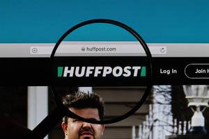 Huffpost logo under magnifying glass