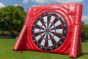 Huge, inflatable dartboard in the club colours of the 1. FC Cologne, for the national soccer league finals at a Park near RheinEnergie football stadium