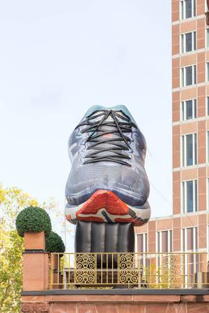 Huge, inflatable running shoe on the balcony