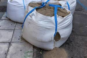 Huge sacks full of sand at a construction site