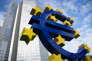 Hugh currency symbol of Europe: Euro sign with stars in front of blue sky