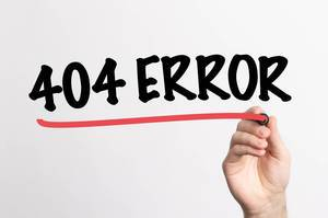 Human hand writing 404 Error on whiteboard