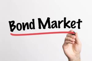 Human hand writing Bond Market on whiteboard