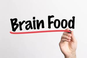 Human hand writing Brain Food on whiteboard