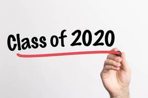 Human hand writing Class of 2020 on whiteboard