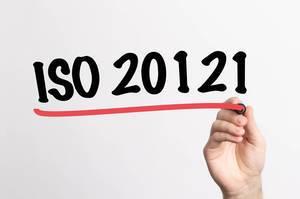 Human hand writing ISO 20121 on whiteboard