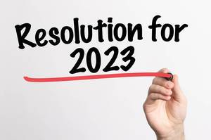 Human hand writing Resolution for 2023 on whiteboard