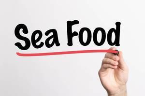 Human hand writing Sea Food on whiteboard