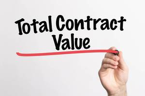 Human hand writing Total Contract Value on whiteboard