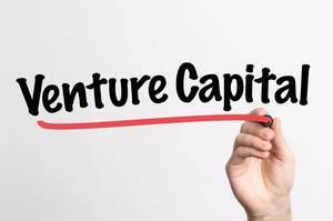 Human hand writing Venture Capital on whiteboard