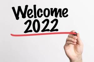 Human hand writing Welcome 2022 on whiteboard