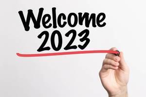 Human hand writing Welcome 2023 on whiteboard