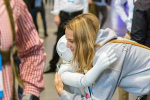 Humanoid robot Pepper by Humanizing Technologies interacts with humans and hugs a woman at Bits & Pretzel