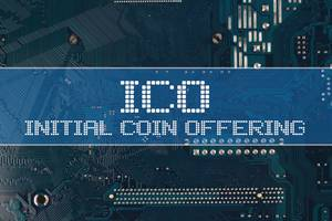 ICO Initial coin offering text over electronic circuit board background