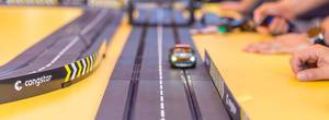 IFA-visitors play with lightning car on Carrera track racing game by Congstar