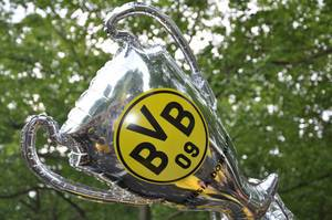 Inflatable Champions League Trophy with Borussia Dortmund Logo raised in the Air
