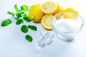 Ingredients for lemonade - sugar, lemons, mint leaves and ice (Flip 2019)