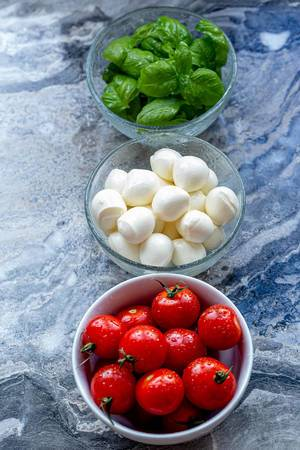Ingredients for making Caprese salad on a grey background (Flip 2019) (Flip 2019)