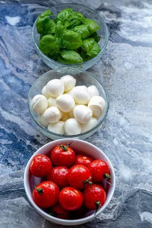 Ingredients-for-making-Caprese-salad-on-a-grey-background.jpg