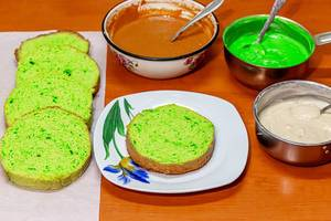 Ingredients for making homemade cake with green sponge cake, condensed milk and custards
