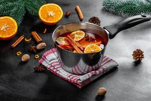 Ingredients for making mulled wine on a black background (Flip 2019)
