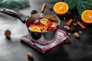 Ingredients for making mulled wine on a black background