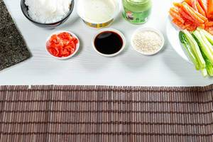 Ingredients for the preparation of rolls and sushi on a table. Food background (Flip 2019)