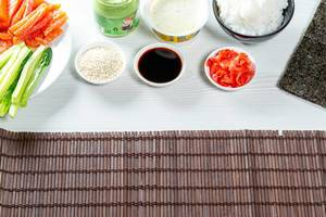 Ingredients for the preparation of rolls and sushi on a table. Food background