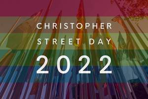 "International flags on flagpoles behind rainbow flag colors, with the picture Titel ""Christopher Street Day 2022"" to celebrate diversity"