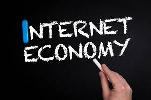 Internet economy text on blackboard